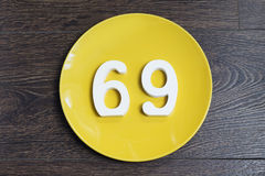 The number sixty-nine on the yellow plate. Royalty Free Stock Image