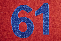 Number sixty-one blue color over a red background. Anniversary. Royalty Free Stock Photography