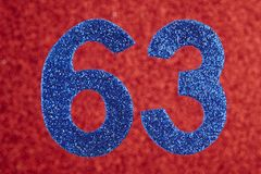 Number sixty-three blue color over a red background. Anniversary royalty free stock image