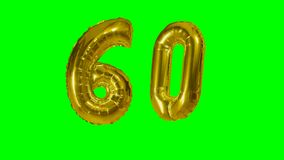 Number 60 sixty years birthday anniversary golden balloon floating on green screen -. Number 60 sixty years birthday anniversary golden balloon floating on green stock footage