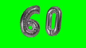 Number 60 sixty years birthday anniversary silver balloon floating on green screen -. Number 60 sixty years birthday anniversary silver balloon floating on green stock video