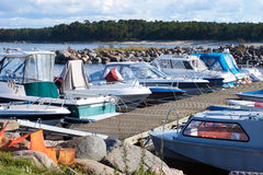 A number of small boats moored in the small harbor on the Baltic sea Stock Image