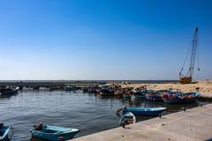 Fishing boats waiting at a small harbor royalty free stock photo