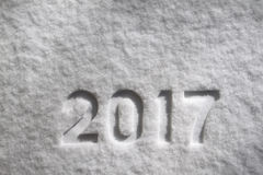 Number 2017 on snow. Number 2017 on natural snow surface, New Year`s background stock image