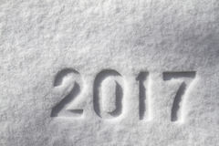 Number 2017 on snow surface. Number 2017 on natural snow surface, New Year`s background royalty free stock images