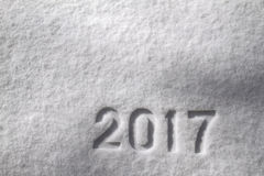 Number 2017 on snow. Number 2017 written on glittering snow, New Year`s background royalty free stock images