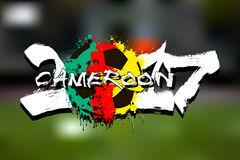 Number 2017 and soccer ball painted in the colors of the Cameroo. Grunge number 2017 and abstract soccer ball painted in the colors of the Cameroon flag. Vector stock illustration