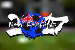 Number 2017 and soccer ball painted in the colors of the New Zea. Grunge number 2017 and abstract soccer ball painted in the colors of the New Zealand flag vector illustration