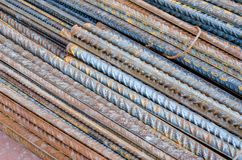 A number of steel rods or deformed rebars used in reinforced concrete with some corrosion. Diagonal pattern. Construction material Stock Photo
