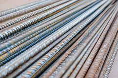 A number of steel rods or deformed rebars used in reinforced concrete with some corrosion. Diagonal pattern. Construction material Royalty Free Stock Image