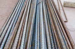 A number of steel rods or deformed rebars used in reinforced concrete with some corrosion. Perspective pattern. Construction material Stock Photography
