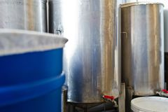 A number of steel tanks for mixing liquids. Stainless steel, food industry. royalty free stock image
