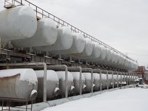 A number of steel tanks for mixing liquids. Stainless steel, food or defense industry. stock photo