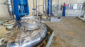 A number of steel tanks for mixing liquids timelapse hyperlapse. Stainless steel, industry. Operator near control panel stock video footage