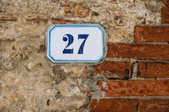 Number 27 on stone and brick wall background Stock Photo