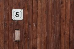 Number of street address with a wooden wall royalty free stock images