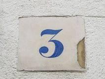 Number 3 street sign. Slab blue and white Stock Photo
