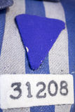 Number and symbol on nazi concentration camp clothes Stock Images