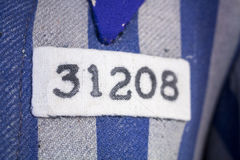 Number and symbol on nazi concentration camp clothes Stock Photos