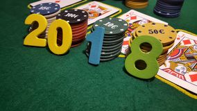 The number 2018 on the table to play poker with cards and poker chips Stock Images