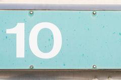 Number 10 ten blue old metal background texture Royalty Free Stock Image