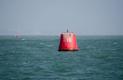 Number ten buoy. A large, red marker buoy, labelled 10 at the entrance to Poole Harbour, Dorset Stock Photo