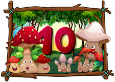 Number ten with 10 mushrooms with faces Royalty Free Stock Images