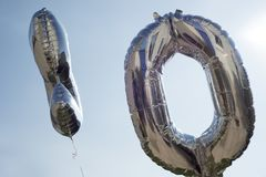 Number ten silver balloons Royalty Free Stock Photo