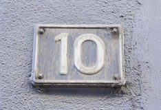Number ten on the wall of a house Stock Images