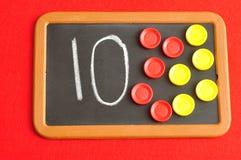 A number ten written on a black board stock image