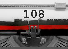 108 Number by the old typewriter on white paper. 108 Number text written by an old typewriter on white sheet Royalty Free Stock Image