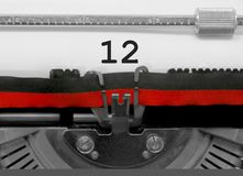 12 Number by the old typewriter on white paper royalty free stock photography