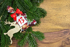 The number thirtee stands on a small bag. Of a christmas calendar Stock Image