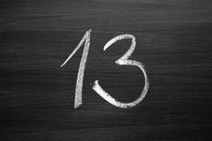 Number thirteen enumeration written with a chalk Royalty Free Stock Photo