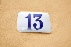 Number Thirteen on Stone Wall Royalty Free Stock Images