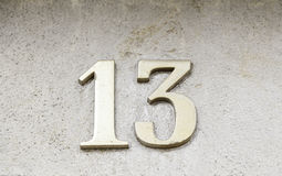 Number thirteen on a wall Stock Images