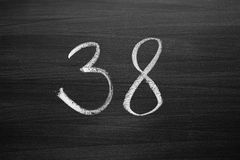 Number thirty eight enumeration written with a chalk Royalty Free Stock Photos
