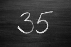Number thirty five enumeration written with a chalk Royalty Free Stock Photography