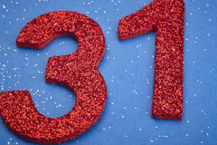 Number thirty one red color over a blue background. Anniversary Stock Photo