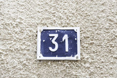 Number thirty-one on a wall Stock Image