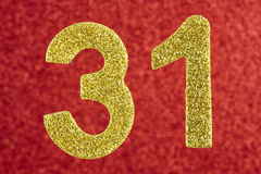 Number thirty-one yellow color over a red background. Anniversar Royalty Free Stock Images