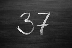 Number thirty seven enumeration written with a chalk Royalty Free Stock Images