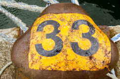Number thirty three bollard. A mooring bollard marked with the number thirty three.  Quay at Southampton Docks, Hampshire Royalty Free Stock Images
