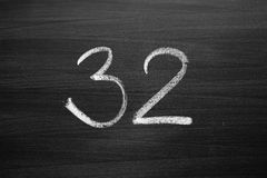 Number thirty two enumeration written with a chalk Royalty Free Stock Images