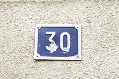 Number thirty on a wall Stock Photography