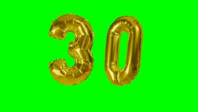 Number 30 thirty years birthday anniversary golden balloon floating on green screen -. Number 30 thirty years birthday anniversary golden balloon floating on stock video
