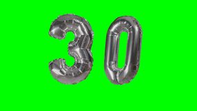 Number 30 thirty years birthday anniversary silver balloon floating on green screen -. Number 30 thirty years birthday anniversary silver balloon floating on stock footage