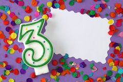 Number three birthday candle. On lilac background Stock Photo