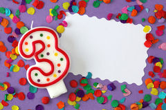 Number three birthday candle. On lilac background Royalty Free Stock Photo