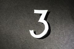 Number three on the black background. Number three on  the black background Stock Photos